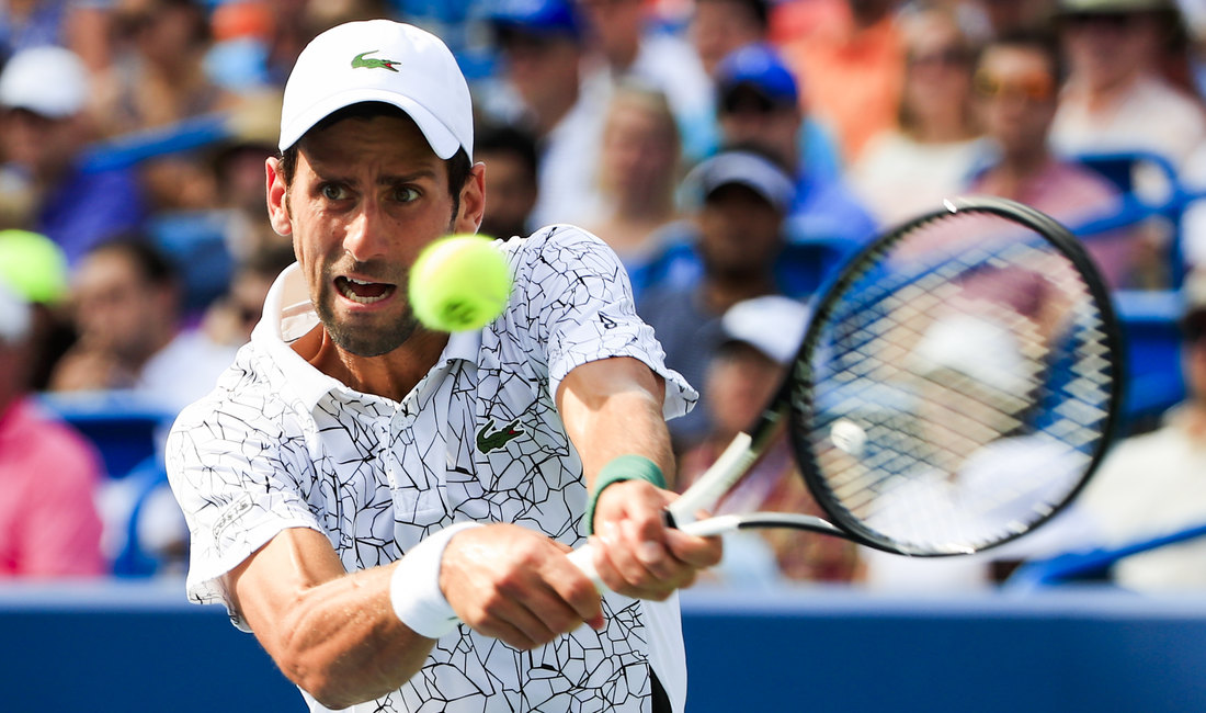 epa06959167 Novak Djokovic of Serbia in action against Roger Federer of Switzerland in their final match in the Western & Southern Open tennis tournament at the Lindner Family Tennis Center in Mason, Ohio, USA, 19 August 2018.  EPA-EFE/TANNEN MAURY